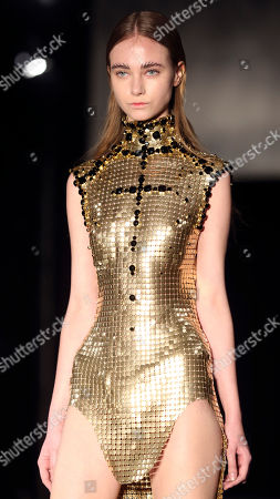 Stock Picture of A model wears a creation for Tex Saverio's ready to wear fall/winter 2014-2015 fashion collection presented in Paris, Tuesday, Feb.25, 2014