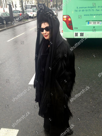 On, Paris-based American-born French fashion blogger Diane Pernet wears a vintage gorilla fur coat before a men's fall-winter 2014-2015 fashion collection in Paris, Thursday, Jan. 16, 2014. The vintage coat made from real gorilla pelt has been condemned by animal rights campaign group PETA