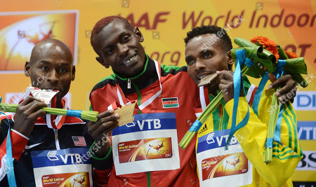 Kenya's gold medal winner Caleb Mwangangi Ndiku is flanked by United States' silver medal winner Bernard Lagat, left, and Ethiopia's bronze medal winner Dejen Gebremeskel during the ceremony for the men's 3000m at the Athletics Indoor World Championships in Sopot, Poland