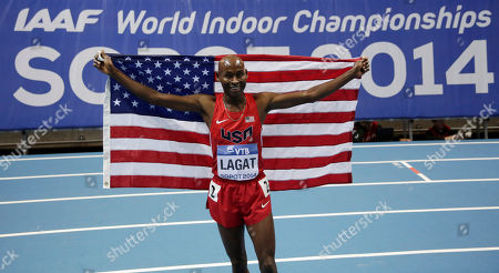 United States' Bernard Lagat celebrates winning the silver medal after the men's 3000m final during the Athletics Indoor World Championships in Sopot, Poland
