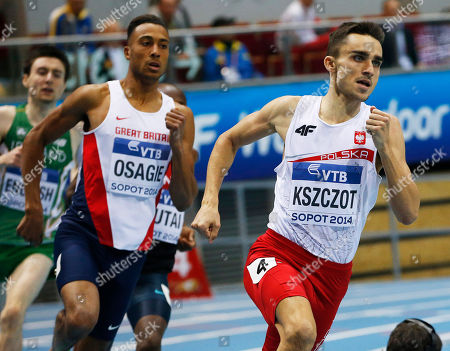 Stock Picture of Poland's Adam Kszczot, right, and Britain's Andrew Osagie run in the men's 800m heat during the Athletics World Indoor Championships in Sopot, Poland