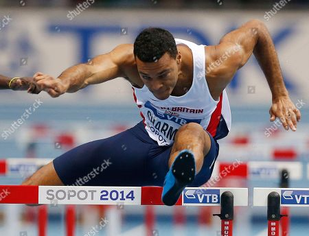 Britain's William Sharman clears a hurdle in his 60m hurdles heat during the Athletics World Indoor Championships in Sopot, Poland