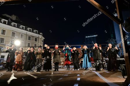 Actors of the Romanian Jewish Theatre perform a play on a makeshift stage outside the theatre, seen on the left, in Bucharest, . The show is, according to the theatre's manager, actress Maia Morgenstern, first on right, part of an appeal for assistance for repairs after snowstorms damaged it's roof, forcing the cancellation of all performances. The Jewish theatre, with performances in Yiddish, started in the northern Romanian city of Iasi in 1876. The building in Bucharest was first used in the 1930's and was nationalized in 1948 when the communists came to power