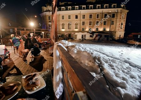 Actors of the Romanian Jewish Theatre perform a play on a makeshift stage outside the theatre, seen in the background, in Bucharest, . The show is, according to the theatre's manager, actress Maia Morgenstern, part of an appeal for assistance for repairs after snowstorms damaged it's roof, forcing the cancellation of all performances. The Jewish theatre, with performances in Yiddish, started in the northern Romanian city of Iasi in 1876. The building in Bucharest was first used in the 1930's and was nationalized in 1948 when the communists came to power