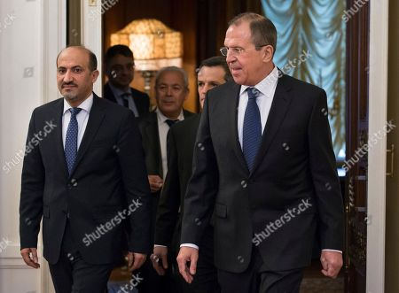 Ahmad Jarba, Sergey Lavrov Russian foreign minister Sergey Lavrov, right, and Ahmad Jarba, left, who heads a delegation of the Syrian National Coalition enter a hall for their talks in Moscow on . Russia welcomed the National Coalition's participation in the Montreux conference on Syria as the confirmation of the coalition's choice in favour of a peaceful settlement of the Syrian conflict, Russian Foreign Minister Sergey Lavrov said today