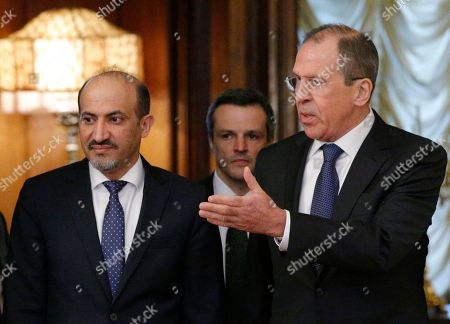 Ahmad Jarba, Sergey Lavrov Russian foreign minister Sergey Lavrov, right, welcomes Ahmad Jarba, left, who heads a delegation of the Syrian National Coalition prior talks in Moscow . Russia welcomed the National Coalition's participation in the Montreaux conference on Syria as the confirmation of the coalition's choice in favour of a peaceful settlement of the Syrian conflict, Russian Foreign Minister Sergey Lavrov said Tuesday