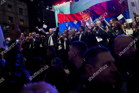 Boris Tadic Boris Tadic, center left, the leader of the New Democratic Party and former Serbian President, lifts his arms as members of his party applaud at a pre election rally in Belgrade, Serbia, . Parliamentary elections in Serbia are set for Sunday, March 16, 2014