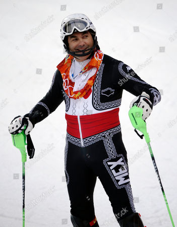 Mexico's Hubertus von Hohenlohe reacts after crashing in the first run of the men's slalom at the Sochi 2014 Winter Olympics, in Krasnaya Polyana, Russia