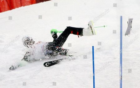 Mexico's Hubertus von Hohenlohe crashes during the first run of the men's slalom at the Sochi 2014 Winter Olympics, in Krasnaya Polyana, Russia