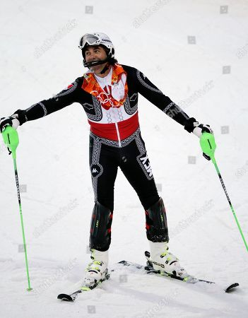 Mexico's Hubertus von Hohenlohe reacts after crashing during the first run of the men's slalom at the Sochi 2014 Winter Olympics, in Krasnaya Polyana, Russia