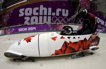 The two-man team from Canada CAN-1, piloted by Lyndon Rush, start their second run during the men's two-man bobsled training at the 2014 Winter Olympics, in Krasnaya Polyana, Russia