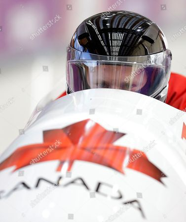 The two-man team from Canada CAN-1, piloted by Lyndon Rush, starts a run during a training session for the men's two-man bobsled at the 2014 Winter Olympics, in Krasnaya Polyana, Russia