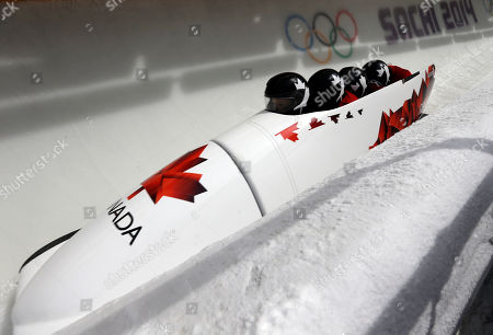 The team from Canada CAN-2, piloted by Lyndon Rush, take a curve during the men's four-man bobsled training at the 2014 Winter Olympics, in Krasnaya Polyana, Russia
