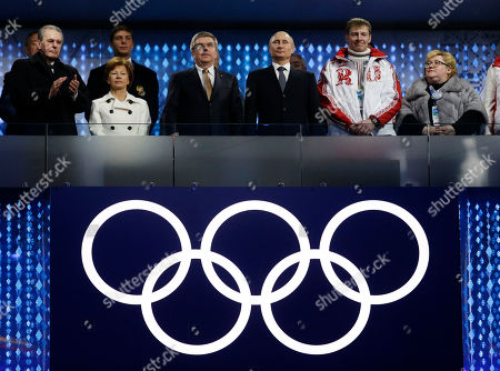 International Olympic Committee (IOC) President Thomas Bach, third from left, and Russian President Vladimir Putin, third from right, and former IOC President Jacques Rogge, left, attend the closing ceremony of the 2014 Winter Olympics, in Sochi, Russia