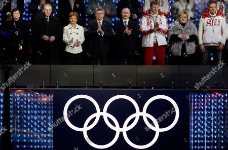 Anne Rogge, former International Olympic Committee (IOC) President Jacques Rogge, Claudia Bach, IOC President Thomas Bach and Russian President Vladimir Putin, from left, applaud a performance during the closing ceremony of the 2014 Winter Olympics, in Sochi, Russia