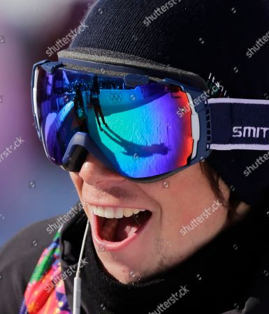Italy's Markus Eder reacts after his run in the men's ski slopestyle qualifying at the Rosa Khutor Extreme Park, at the 2014 Winter Olympics, in Krasnaya Polyana, Russia