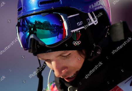 Italy's Markus Eder waits for his score after a run in the men's ski slopestyle qualifying at the Rosa Khutor Extreme Park, at the 2014 Winter Olympics, in Krasnaya Polyana, Russia