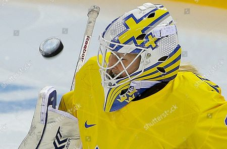 Goalkeeper Kim Martin Hasson of Sweden blocks a shot by the USA during the third period of the 2014 Winter Olympics women's semifinal ice hockey game at Shayba Arena, in Sochi, Russia