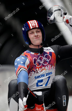 Aidan Kelly of the United States brakes in the finish area after his first run during the men's singles luge competition at the 2014 Winter Olympics, in Krasnaya Polyana, Russia