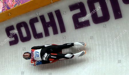 Aidan Kelly of the United States takes turn five in the third run during the men's singles luge final at the 2014 Winter Olympics, in Krasnaya Polyana, Russia