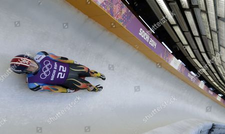 Aidan Kelly of the United States takes a turn during a training session for the men's singles luge at the 2014 Winter Olympics, in Krasnaya Polyana, Russia