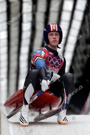 Aidan Kelly of the United States brakes in the finish area after his final run during the men's singles luge final at the 2014 Winter Olympics, in Krasnaya Polyana, Russia
