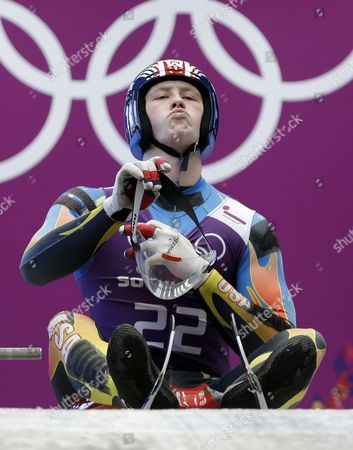 Aidan Kelly of the United States prepares to start a run during a training session for the men's singles luge at the 2014 Winter Olympics, in Krasnaya Polyana, Russia