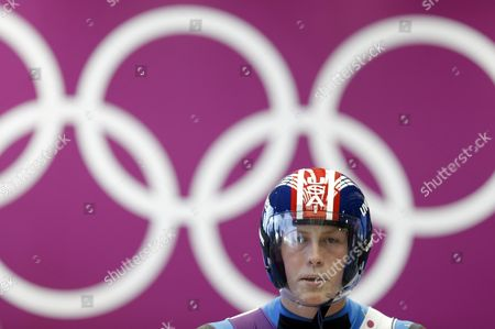 Aidan Kelly of the United States prepares to start his run during a training session for the men's singles luge at the 2014 Winter Olympics, in Krasnaya Polyana, Russia
