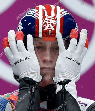 Aidan Kelly of the United States prepares for his first run during the men's singles luge competition at the 2014 Winter Olympics, in Krasnaya Polyana, Russia