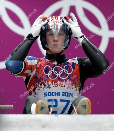 Aidan Kelly of the United States prepares to start his second run during the men's singles luge competition at the 2014 Winter Olympics, in Krasnaya Polyana, Russia