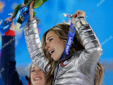 Women's skeleton silver medalist Noelle Pikus-Pace of the United States celebrates during the medals ceremony at the 2014 Winter Olympics, in Sochi, Russia