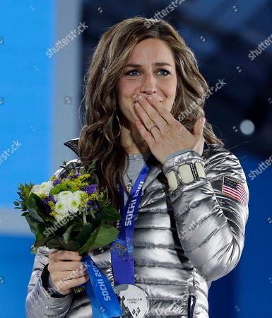 Women's skeleton silver medalist Noelle Pikus-Pace of the United States stands on the podium during the medals ceremony at the 2014 Winter Olympics, in Sochi, Russia