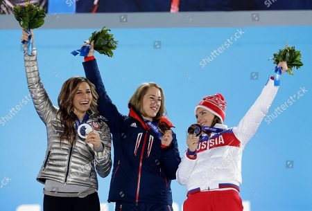 Women's skeleton medalists, from left, Noelle Pikus-Pace of the United States, silver, Elizabeth Yarnold of Britain, gold, and Elena Nikitina of Russia, bronze, pose with their medals at the 2014 Winter Olympics in Sochi, Russia