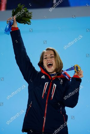 Women's skeleton gold medalist Elizabeth Yarnold of Britain celebrates during the medals ceremony at the 2014 Winter Olympics, in Sochi, Russia