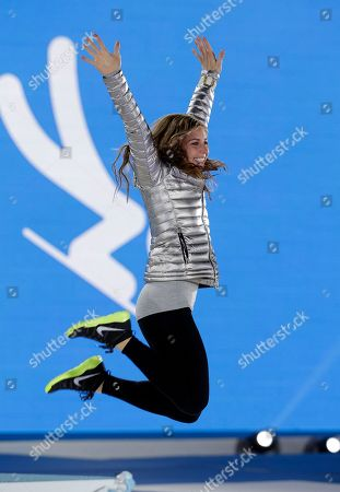 Stock Photo of Women's skeleton silver medalist Noelle Pikus-Pace of the United States jumps on the podium during the medals ceremony at the 2014 Winter Olympics, in Sochi, Russia