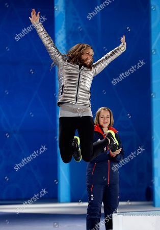 Women's skeleton silver medalist Noelle Pikus-Pace of the United States jumps on the podium during the medals ceremony at the 2014 Winter Olympics, in Sochi, Russia