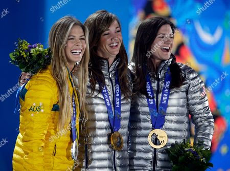 Women's snowboard halfpipe medalists, from left, Torah Bright of Australia, silver, Kaitlyn Farrington of the United States, gold, and Kelly Clark of the United States, bronze, pose with their medals at the 2014 Winter Olympics in Sochi, Russia