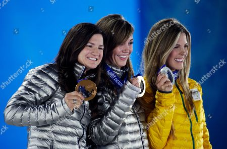Women's snowboard halfpipe medalists, from left, Kelly Clark of the United States, bronze, Kaitlyn Farrington of the United States, gold, and Australia's Torah Bright, silver, pose with their medals at the 2014 Winter Olympics in Sochi, Russia
