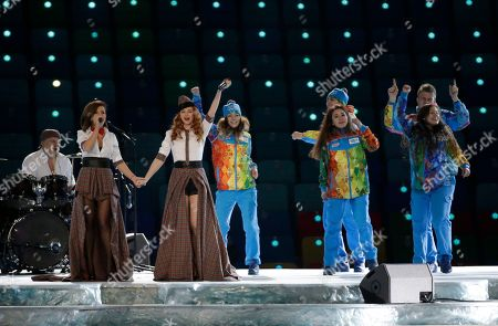 Russian duo t.A.T.u. Lena Katina, third from left, and Yulia Volkova, second from left, perform on stage before the opening ceremony of the 2014 Winter Olympics in Sochi, Russia