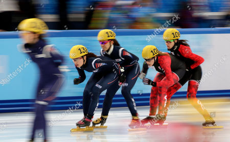 Park Seung-hi of South Korea, left, is given a push by Cho Ha-ri of South Korea, second from left, as Marianne St-Gelais of Canada, second from right, is given a push by Jessica Hewitt of Canada as they compete in a women's 3000m relay short track speedskating semifinal at the Iceberg Skating Palace during the 2014 Winter Olympics, in Sochi, Russia