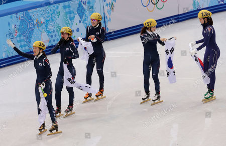 From left, Cho Ha-ri of South Korea, Park Seung-hi of South Korea, Kim Alang of South Korea, Kong Sang-jeong of South Korea and Shim Suk-Hee of South Korea celebrate after the team won the women's 3000m short track speedskating relay final at the Iceberg Skating Palace during the 2014 Winter Olympics, in Sochi, Russia