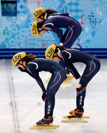 From front to back, Park Seung-hi of South Korea, Kim Alang of South Korea, Shim Suk-Hee of South Korea and Cho Ha-ri of South Korea react after winning the women's 3000m short track speedskating relay final at the Iceberg Skating Palace during the 2014 Winter Olympics, in Sochi, Russia