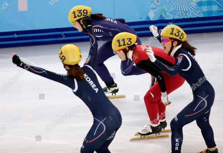 From left, Park Seung-hi of South Korea, Shim Suk-Hee of South Korea, Zhou Yang of China, and Cho Ha-ri of South Korea compete in the women's 3000m short track speedskating relay final at the Iceberg Skating Palace during the 2014 Winter Olympics, in Sochi, Russia
