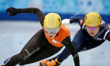 Lara Van Ruijven of the Netherlands competes in a women's 500m short track speedskating heat at the Iceberg Skating Palace during the 2014 Winter Olympics, in Sochi, Russia