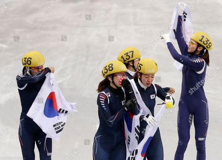 Stock Picture of From left, Kim Alang of South Korea, Park Seung-hi of South Korea, Kong Sang-jeong of South Korea, Cho Ha-ri of South Korea and Shim Suk-Hee of South Korea celebrate after winning in the women's 3000m short track speedskating relay final at the Iceberg Skating Palace during the 2014 Winter Olympics, in Sochi, Russia