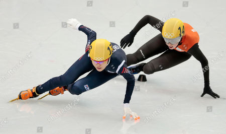 Kim Alang of South Korea, left, and Lara Van Ruijven of the Netherlands compete in a women's 500m short track speedskating heat at the Iceberg Skating Palace during the 2014 Winter Olympics, in Sochi, Russia