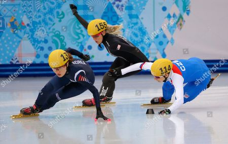 Katerina Novotna of the Czech Republic, right, crashes out as she competes with Emily Scott of the United States, centre, and Park Seung-hi of South Korea in a women's 1000m short track speedskating heat at the Iceberg Skating Palace during the 2014 Winter Olympics, in Sochi, Russia