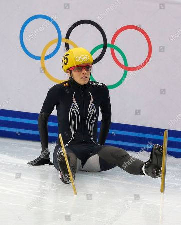 Emily Scott of the United States crashes out in a women's 1000m short track speedskating quarterfinal at the Iceberg Skating Palace during the 2014 Winter Olympics, in Sochi, Russia