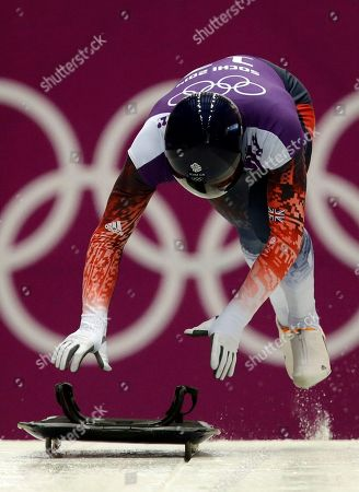 Kristan Bromley of Britain starts his run during the men's skeleton singles training at the 2014 Winter Olympics, in Krasnaya Polyana, Russia