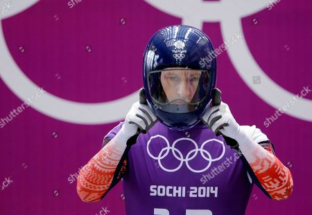 Kristan Bromley of Great Britain prepares to start a run during the men's skeleton training at the 2014 Winter Olympics, in Krasnaya Polyana, Russia